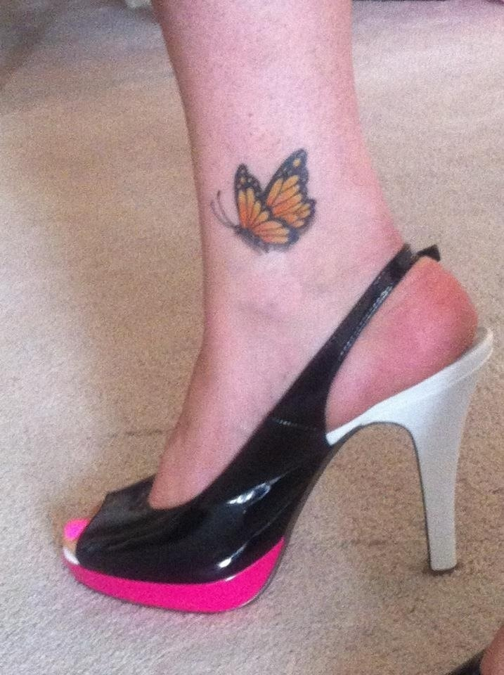 Amaze small butterfly tattoo on foot for stunning girls