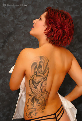 Amaze tattoo on back for amazing girls