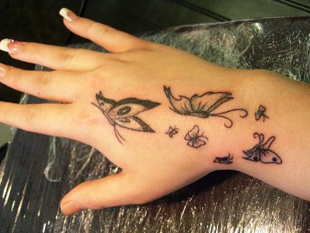 Cool 3d butterfly tattoo on hand for beautiful girls