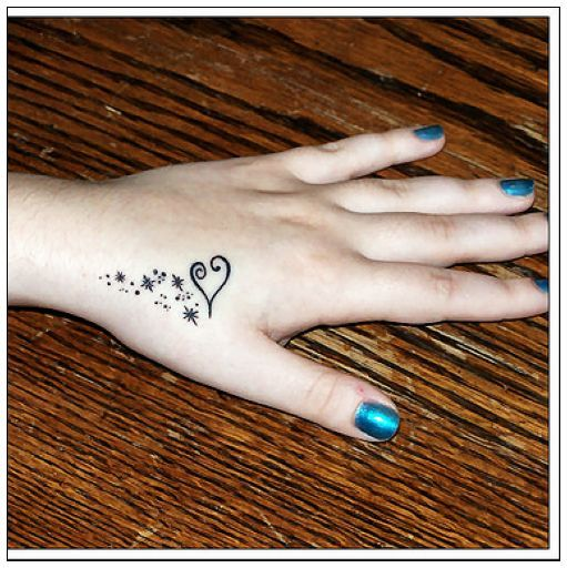 Cute and small heart tattoo on hand for valentine love