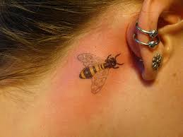 Extremely beautiful bee tattoo design behind ear for cool look
