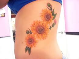 Extremely beautiful small flower tattoo on rib for women