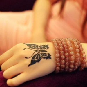 Fabulous butterfly tattoo for stunning girls on hand