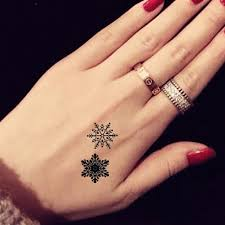 Fabulous small star tattoo design on hand for women
