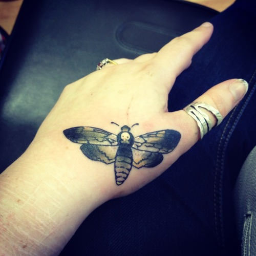 Fantastic butterfly tattoo on hand for stunning look