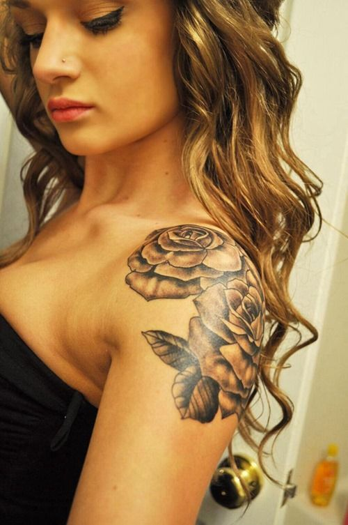 Fantastic flower tattoo on shoulder for amazing girly look