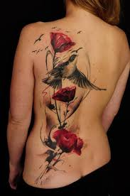 Fantastic water color art tattoo on back for women