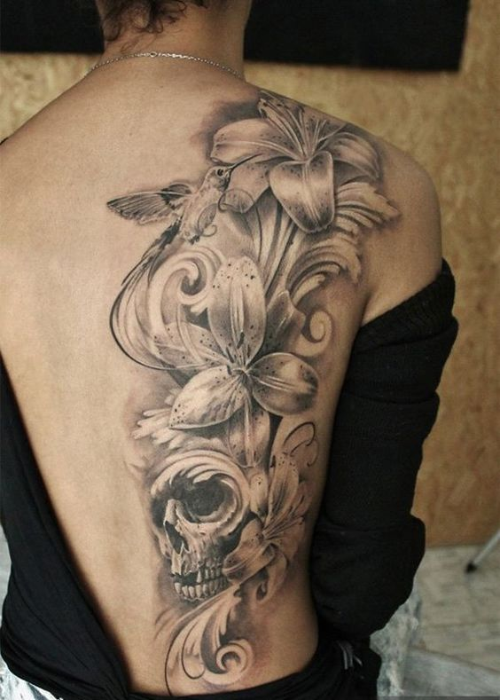 Fashionable flower tattoo on back for fab look