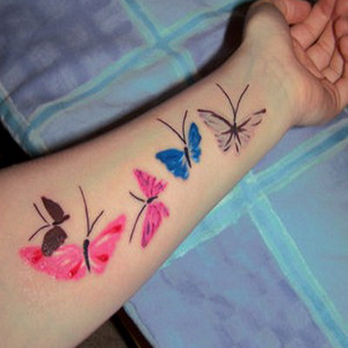Free colored butterfly tattoo designs on arm for her