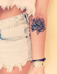 Incredible small flower tattoo on arm for women