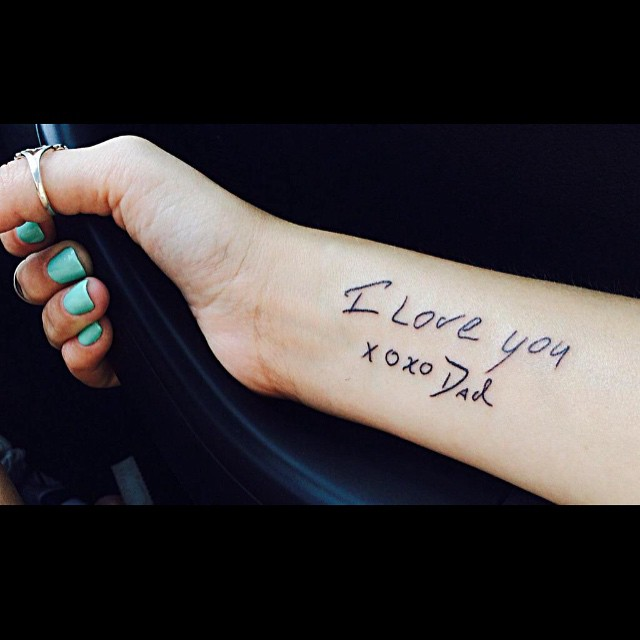 Loveable romantic written tattoo on arm for women