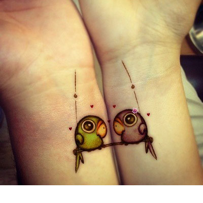 fantastic bird tattoos for couple on wrist