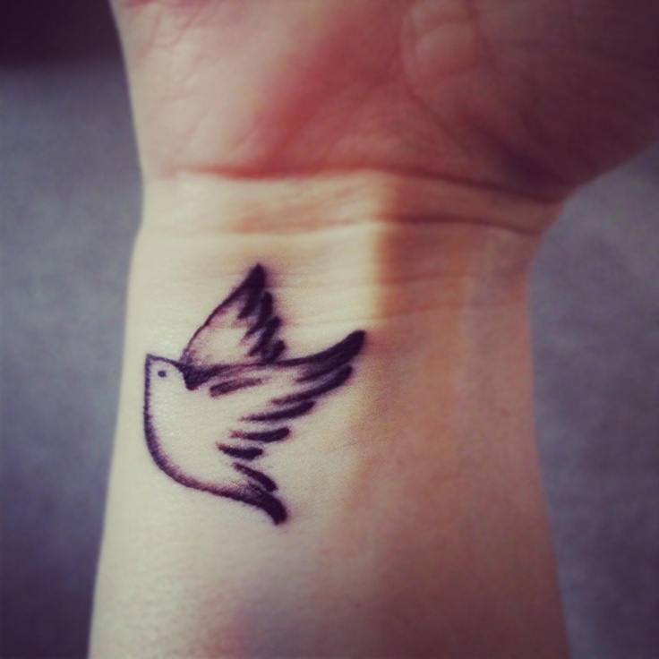 romantic small flying bird tattoo on wrist for boys