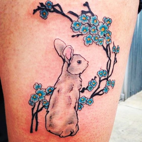 3d rabbit tattoo with colored flowers