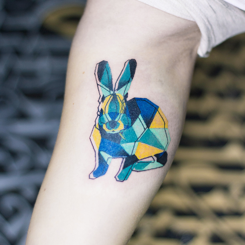 3d rabbit tattoo with colors on arm