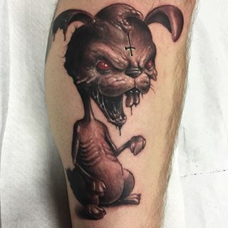 Aggresive rabbit tattoo on arm for boys and girls