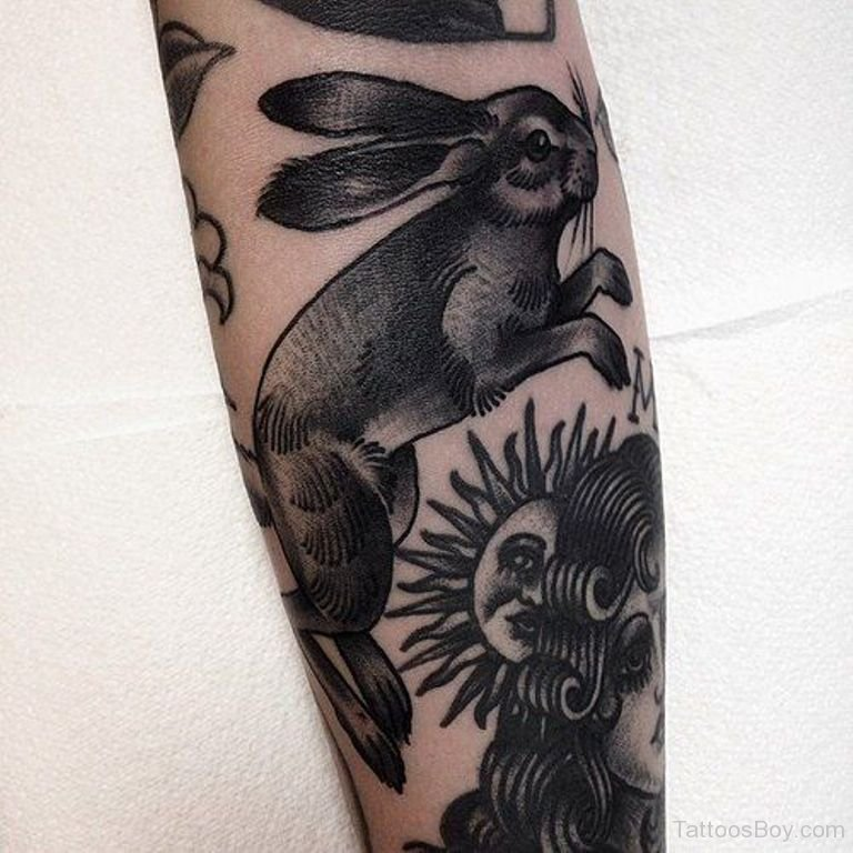 Artistic rabbit tattoo on leg