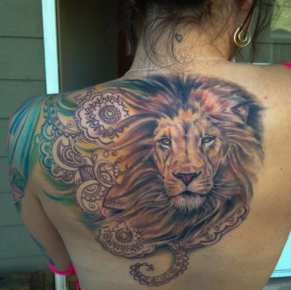 Awesome lion tattoo on back for girls