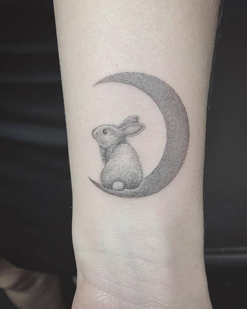Awesome rabbit on moon tattoo