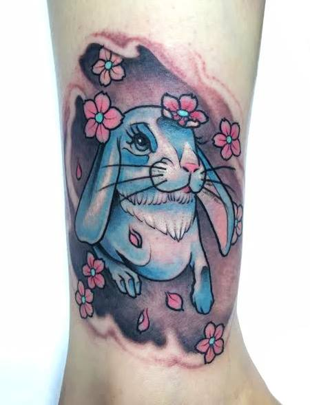 Beautiful blue rabbit tattoo on wrist