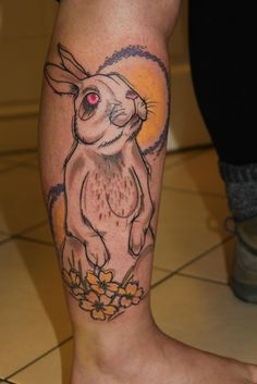 Beautiful rabbit tattoo with moon on leg