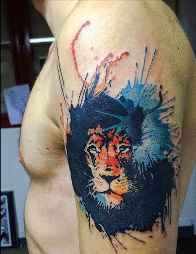 Colored lion tattoo on arm