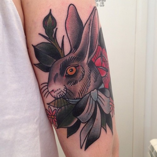 Colorful rabbit tattoo on arm for men
