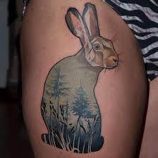 Cool rabbit tattoo with green grass
