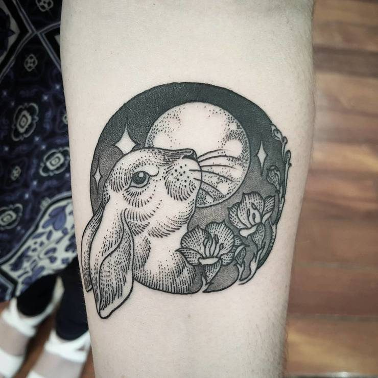 Cute moon rabbit tattoo on arm