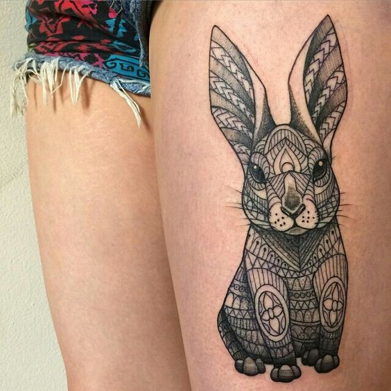 Fabulous geometrical rabbit tattoo idea on thigh