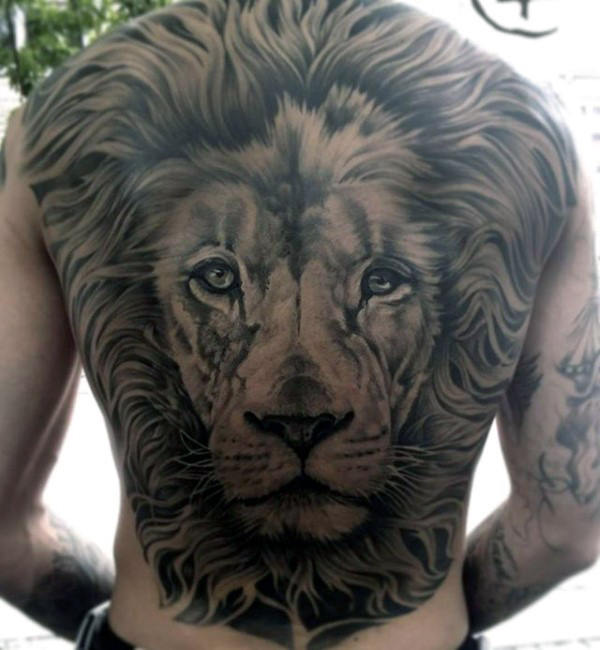 Fearful back lion tattoo design idea