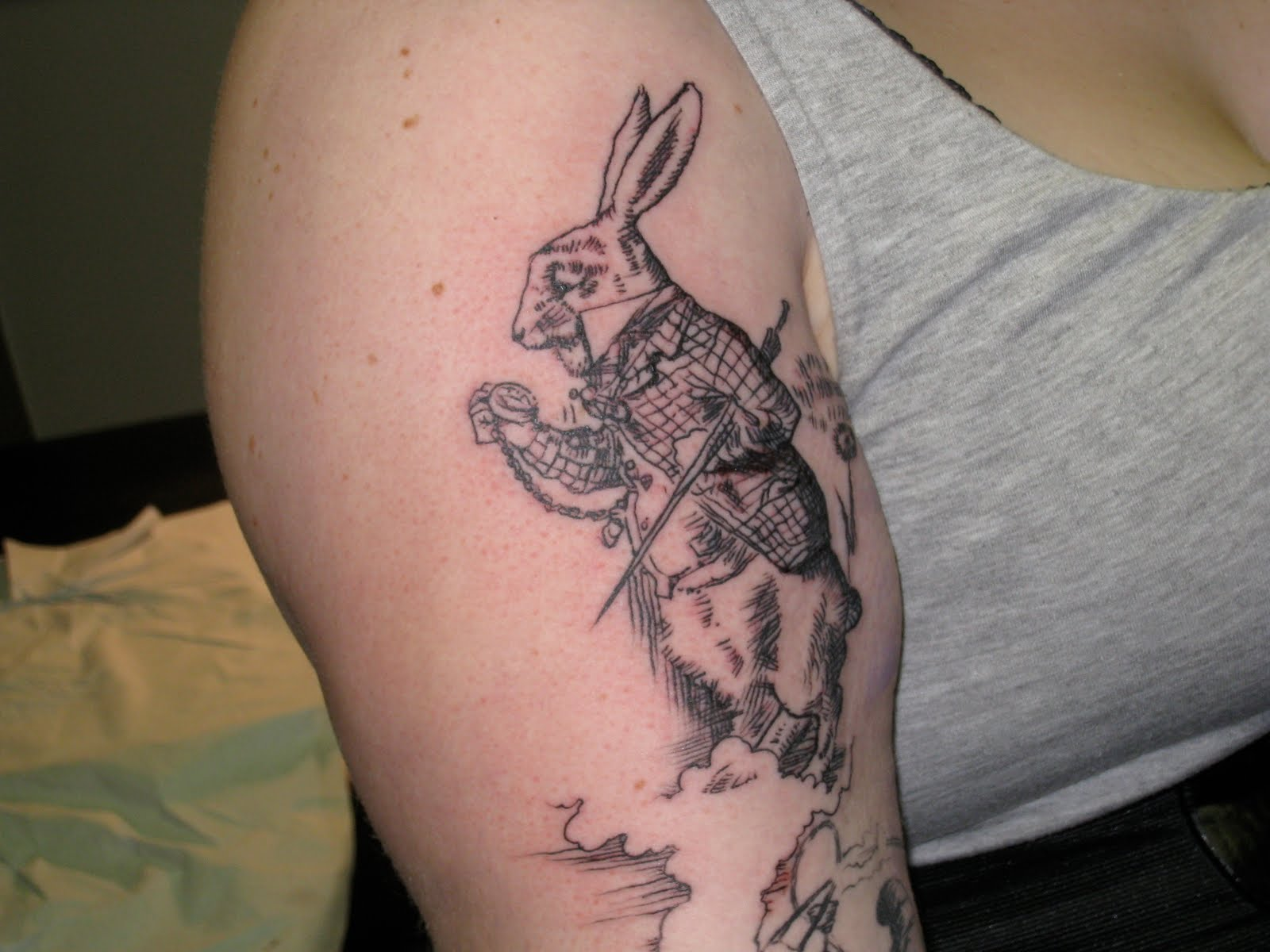 Funny rabbit tattoo on arm