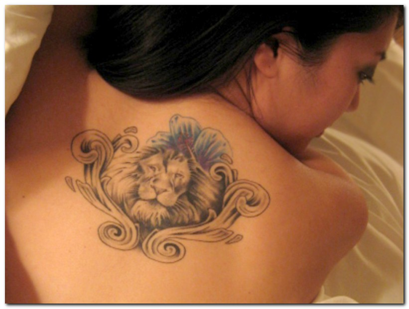 Geometrical lion tattoo on back