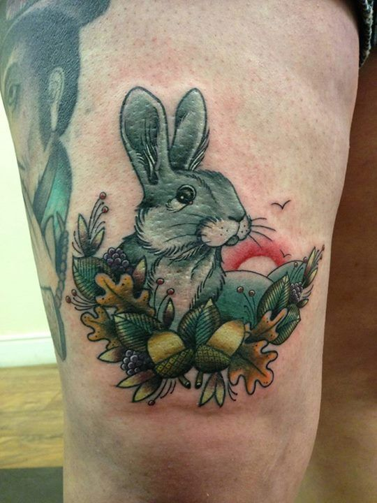 Green ink rabbit tatoo on thigh for men