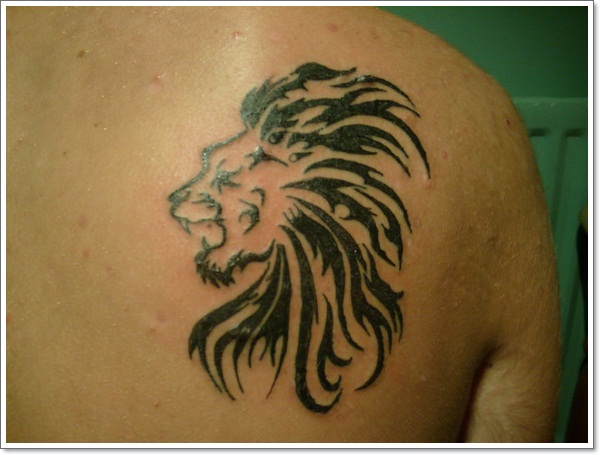 Lion tattoo by famous tattoo artist