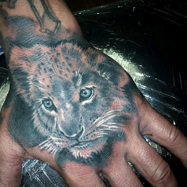 Meaningful lion tattoo on hand
