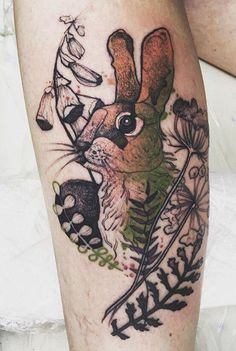 Perfect colorful rabbit tattoo on leg