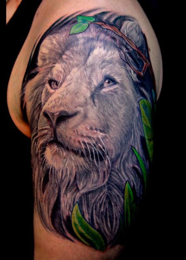 Sensational lion tattoo on arm for boys
