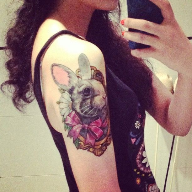Spectacular rabbit tattoo idea for arm