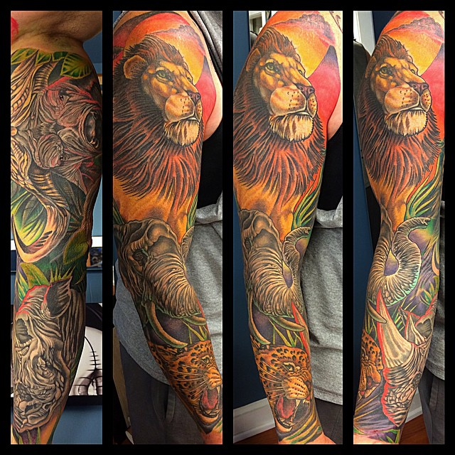 Superb lion tattoo design on arm