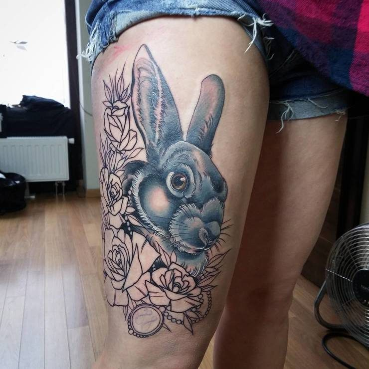 Unique colored rabbit tattoo on thigh