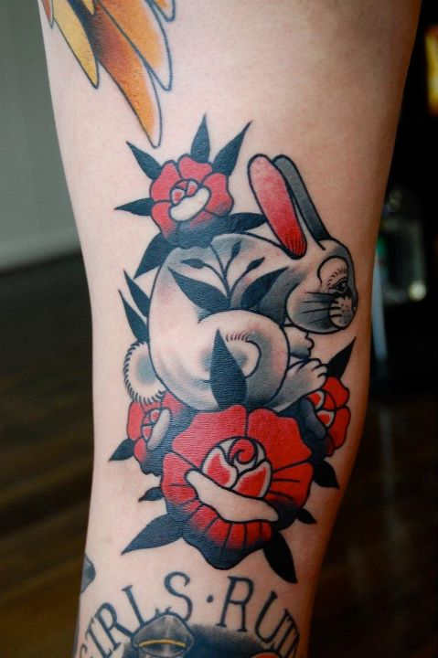 Wondeful colored rabbit tattoo on arm