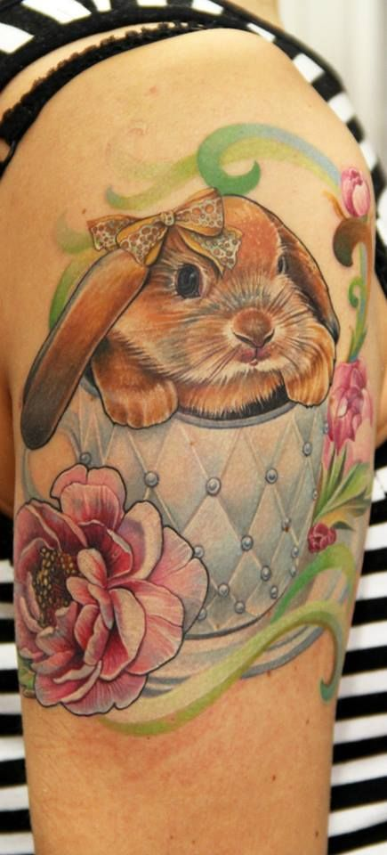 Wonderful cute rabbit tattoo on arm for women