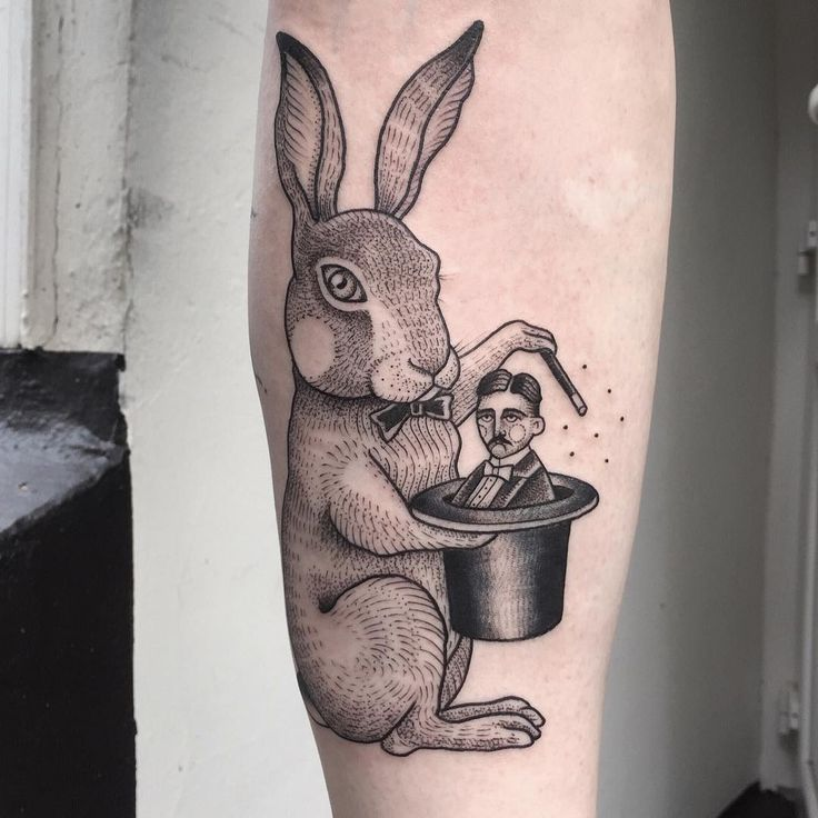 Wonderful rabbit tattoo with magical hat