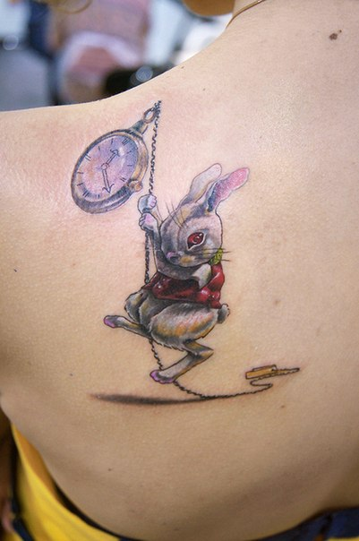 amazing rabbit tattoo with clock on shoulder