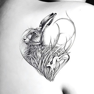 artistic rabbit tattoo on shoulder for women