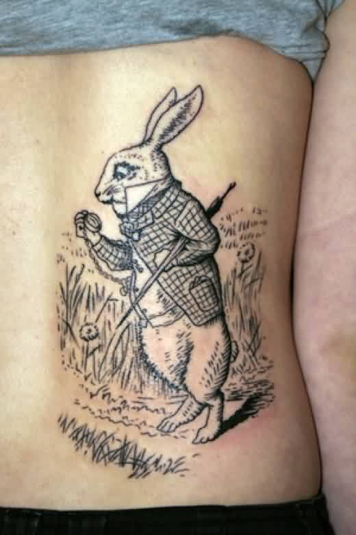 awesome rabbit tattoo with grass on back