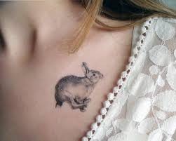 beautiful bunny tattoo on chest for girls