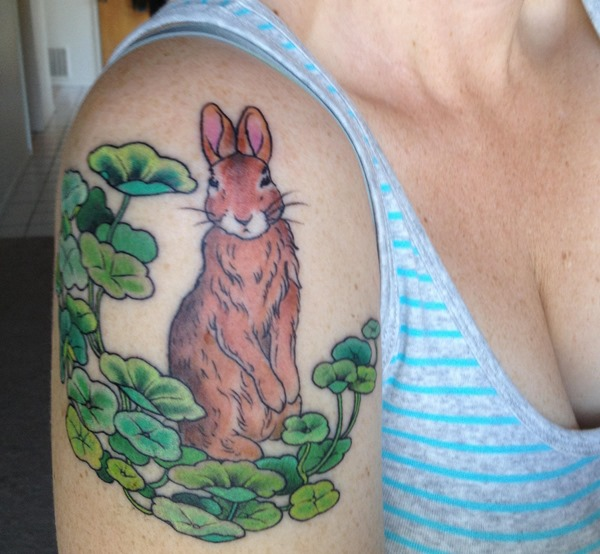 beautiful rabbit tattoo on arm in brown color