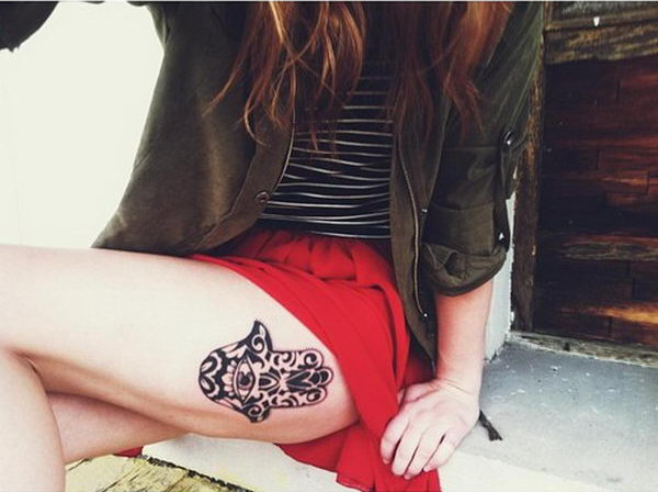 best hamsa tattoo - on thigh